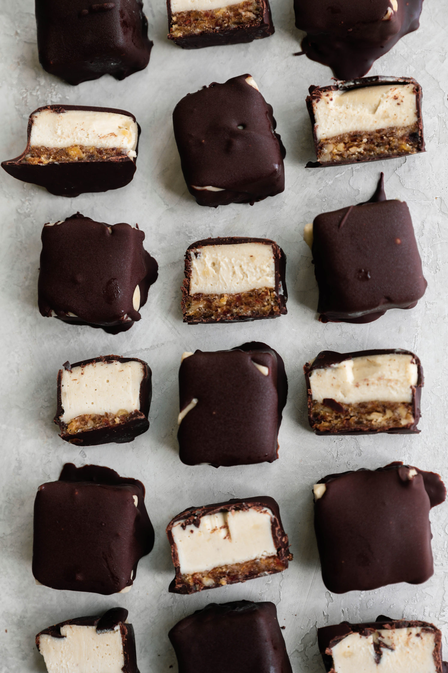 Chocolate Dipped Cashew Cheesecake Bites by Flora & Vino