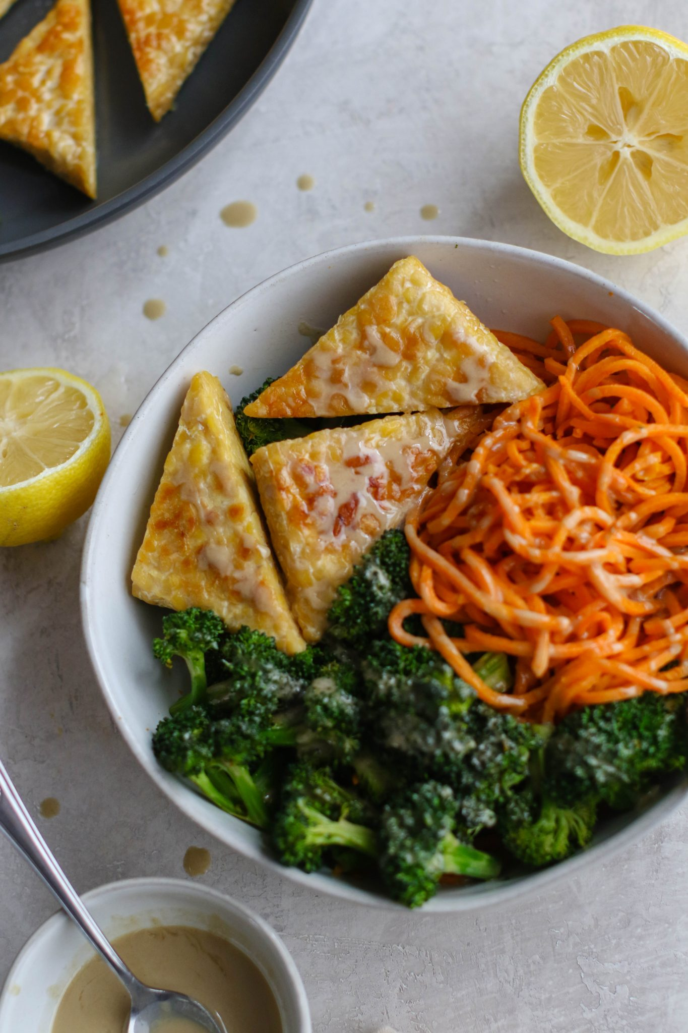 Tahini Tempeh, Sweet Potato Noodle, & Broccoli Bowl by Flora & Vino
