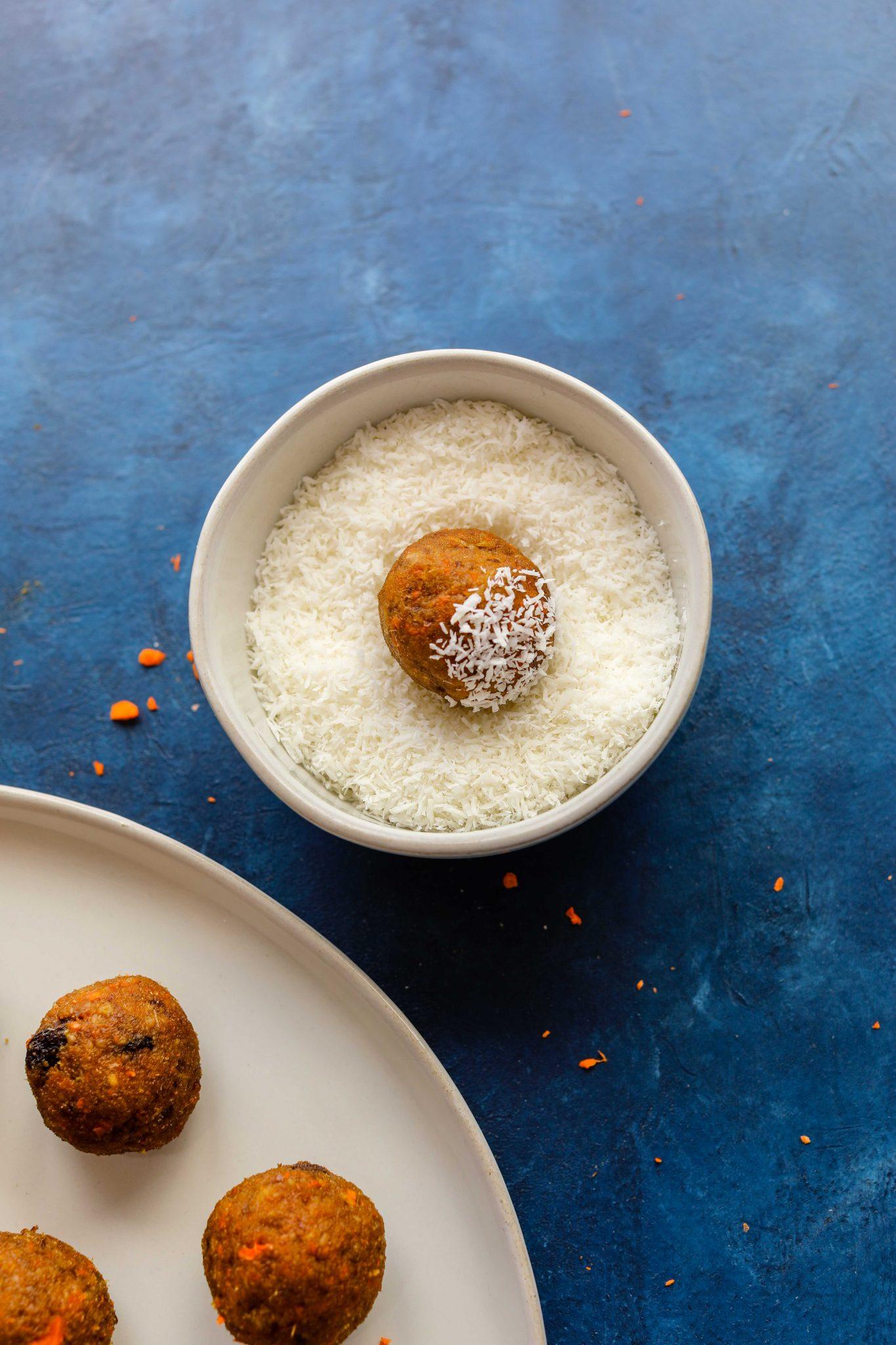 Carrot Cake Bliss Balls (Grain-Free!) rolled in shredded coconut